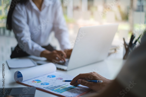 Fototapeta Group of Businessman and Accountant checking data document on digital tablet for investigation of corruption account