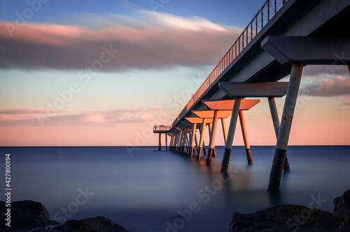 Obraz na plátně Lifeguard Hut On Sea Against Sky During Sunset