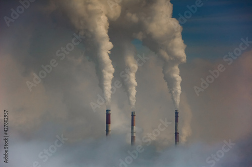 Smoke Emitting From Chimney Against Sky Fototapet