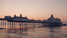 Eastbourne Seafront At Sunrise With Calm Sea And Clear Skies.