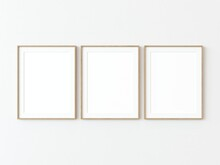 Three Light Wood Thin Rectangular Vertical Frame Hanging On A White Textured Wall Mockup, Flat Lay, Top View, 3D Illustration