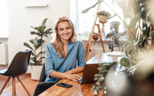 Positive Business Woman And Her Occupation In Cosy Office In Daytime