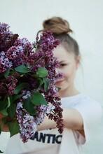 Portrait Of Woman By Purple Flowering Plant