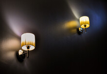 Low Angle View Of Illuminated Lamp Mounted On Wall