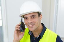 Portrait Of A Engineer Using A Walkie Talkie
