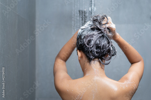 Canvas Asian women bathing and washing hair.she is happy
