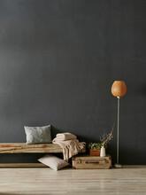 Modern Decorative Dark Grey Stone Wall Background With Wooden Bench Orange Lamp Blanket And Pillow Home Design, Interior Still Life.