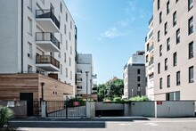 Residential Buildings By Road Against Sky