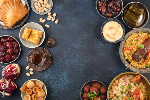Slika na platnu Ramadan kareem Iftar party table with assorted festive traditional Arab dishes, sweets, dates
