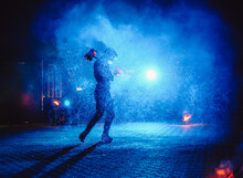 A Fire Show, Dancing With A Flame, A Masculine Master Juggling With A Firework. Film Noise