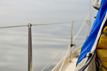 Close-up Of Rope Hanging On Railing Against Sea
