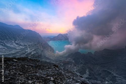 Carta da parati Smoke Emitting From Volcanic Mountain Against Sky During Sunset