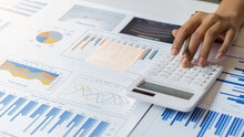 An Accountant, Businessman Or Finance Professional Analyzes Graphs, Business Reports And Financial Charts At The Office Of Financial Economics Concepts.
