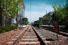 Low Angle View Of Light Rail Tracks Leading To Platform In Charlotte, North Carolina, USA