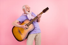 Photo Portrait Of Funky Happy Grandpa Playing Guitar Smiling Like Rock Star Isolated On Pastel Pink Color Background