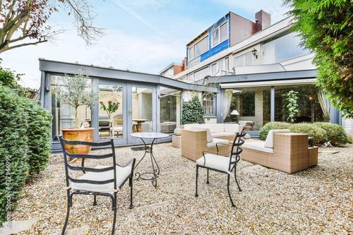 Beautiful backyard terrace full of furniture and decorative plants Fototapeta
