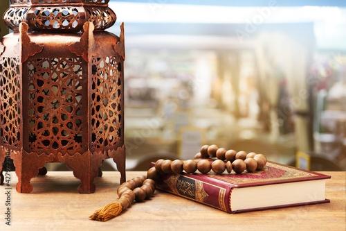 Fotografie, Obraz Islamic Holy Book Quran with rosary beads and ornamental Arabic lantern