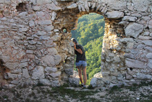 Full Length Of Woman Standing By Old Ruins Outdoors