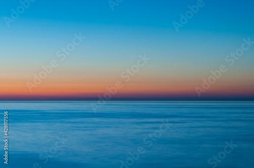 Fototapeta Zachód słońca nad morzem Bałtyckim, Brzask na horyzoncie / Sunset on the Baltic Sea, Dawn on the horizon obraz