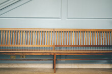 Empty Long Wooden Bench In A Building