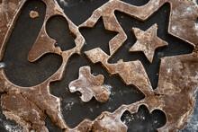 Tiny Gingerbread Man Cutout In Scraps Of Dough