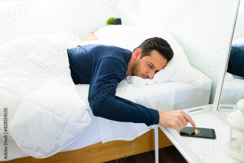 Canvas Latin man does not want to get out of bed