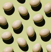 Chicken Eggs On Green Background Pattern