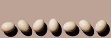 Chicken Eggs On Beige Background Copy Space