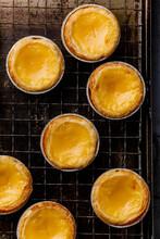 Pastel De Nata Fresh Baked Portuguese Egg Custard Tart On Cooling Rack