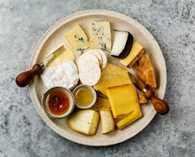 Cheese Plate With Different Types Of Cheese Snack Assortment On Plate