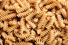 Macro Shot Of Dried Fusilli Pasta.