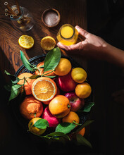 Citrus In A Basket. And Fresh Juice.