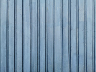 Closeup of a blue wooden wall texture and background. Free space for your text.
