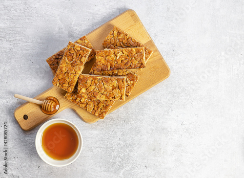 Fotografie, Obraz Almond florentines or Bee sting, thin shortbread covered cookies with honey