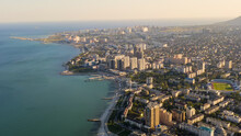 Novorossiysk, Russia. Panorama Of The City And The Embankment. Tsemesskaya Bay In The Black Sea, Aerial View