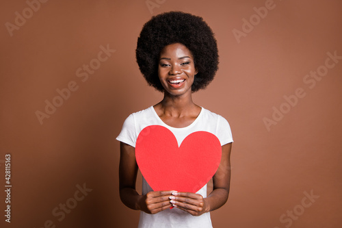 Photo of cheerful romantic girl hold red paper heart toothy smile wear white t-s Fototapet