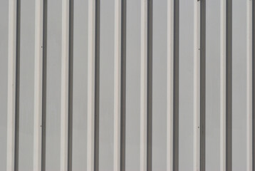Close Up of Vertical Lines of Grey Corrugated Steel Wall