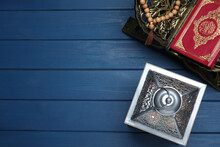 Arabic Lantern, Quran And Misbaha On Blue Wooden Table, Flat Lay. Space For Text