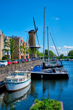 View Of The Harbour Of Delfshaven And The Old Grain Mill De Destilleerketel. Rotterdam, Netherlands