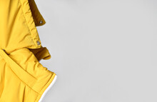 Close-up Of The Hood From A Yellow Padded Jacket. There Is A Place For Your Advertisement