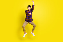 Full Body Photo Of Young Excited Man Happy Positive Smile Cowboy Ride Horse Rodeo Isolated Over Yellow Color Background