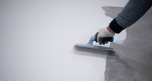 Worker Works With Polyurethane Resin For Interiors