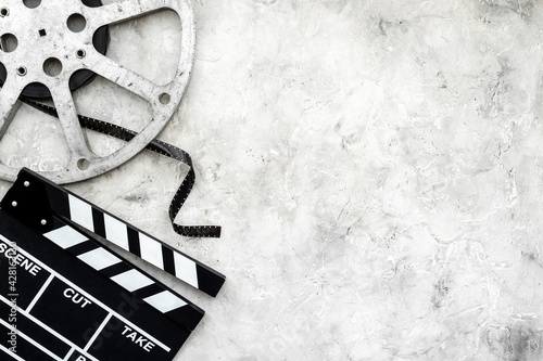 Photo Cinema background with movie clapperboard and film reel