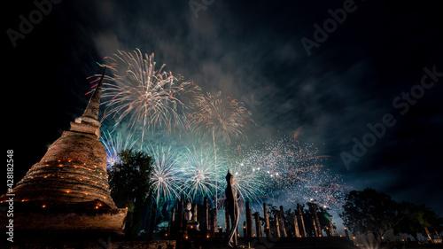 Fotografie, Obraz Firework of Loy Krathong festival showing in Sukhothai historical park