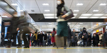 Crowd Of People Wearing Surgical Masks At Railway Station In Tokyo, Japan 駅の構内を行き交う人々 マスクをつけた女性