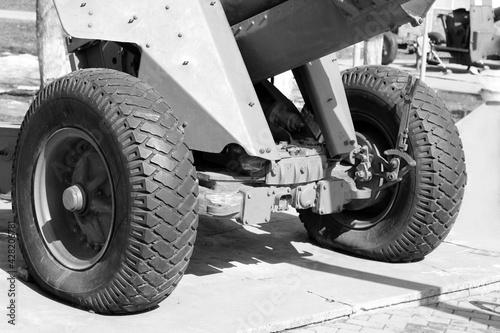 Billede på lærred Ancient cannon on wheels, black and white