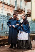 A Man In A Nineteenth Century Suit And A Woman In A Historical Dress.