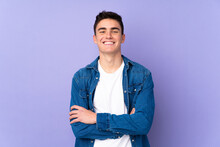 Teenager Caucasian  Handsome Man Isolated On Purple Background Keeping The Arms Crossed In Frontal Position