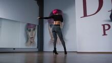 High Heels Woman Dancing In Studio. Sexy Dancer Bending On Dance Floor.
