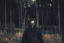Person Wearing A Creepy Taxidermy Mask In An Autumn Forest